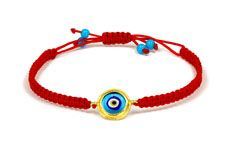 23.75 karat yellow gold red macreme bracelet with small clear blue enamel evil eye. Available for purchase online at www.leonardojewelers.com and in our Red Bank, NJ and Elizabeth, NJ stores.