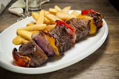 Shish Kebab Generous cubes of filet mignon skewered with peppers, onion & mushrooms, marinated in our special house sauce Shish Kebab, Stuffed Mushrooms, Stuffed Peppers, Skewers, Cubes, Onion, Steak, House, Food