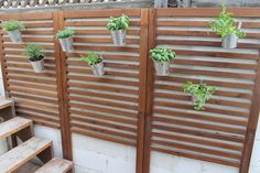 Make an outdoor wall o' greenery using Äpplarö wall panels and Socker planters.