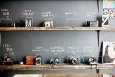 """cool for some """"art"""" {vintage camera display, reclaimed shelving and chalkboard wall} could also incorporate some vintage Mic's and radios for """"sound"""" element Old Cameras, Vintage Cameras, Antique Cameras, Vintage Camera Decor, Polaroid Cameras, Vintage Display, Vintage Typewriters, Digital Cameras, Labo Photo"""