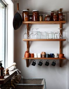 Kitchen sink and shelves with preserves by Matt and Lentil. Photo by Eve Wilson, styling by Stefanie Stamatis for The Design Files.