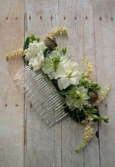 Incorporating floral accents like wedding flower hair designs into your budget wedding decor can be a breeze. Find out how here...