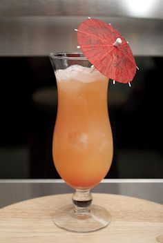 99 Days in Paradise ---- 1 1/2 oz Malibu Passion Fruit rum * 1 1/2 oz banana liqueur * 2 oz orange juice * 2 oz pineapple juice * 1/4 oz grenadine ---- In a shaker add ice and all ingredients except for the grenadine.  Shake and strain into a hurricane glass filled 3/4  with crushed ice.  Pour grenadine on top.