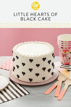 Nothing says classic like black and white, and this Little Hearts of Black Cake is about as classy as it gets! A cute dessert for birthdays and other celebrations, this cake is an easy project for beginners and offers plenty of room on top for a customized message or candles. #wiltoncakes #cakes #cakedecorating #cakeideas #homemade #baking #buttercreamcake #buttercreamfrosting #hearts #love #valentinesday #valentinesgift #valentinestreat #valentinesdiy #cakedecoratingtechniques #pipingtips