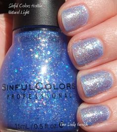 August 2012: Sinful Colors in : #831 Hottie: It's a small and medium mixed blue, sliver and pink glitter with a pale blue tinted clear coat. the glitter to clear coat ratio is 50/50 and in 1 coat this is the color you get but I found that you can get the color of the bottle on your claws in 3 coats. I picked it up to do a cinderella nail art mani for the glass slipper but remembered I have a micro glitter I can use . win win as this polish is super cute