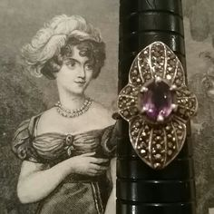 Vintage Sterling Silver Amethyst Marcasite Ring Vintage 925 sterling silver faceted Amethyst and  Marcasite ring. Size 6.5. Original patina intact.  Excellent vintage condition. No missing stones. Lots of sparkle.  Reasonable offers accepted. Vintage Jewelry Rings