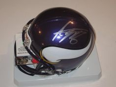 Adrian Peterson Minnesota Vikings Signed Autographed Mini Helmet with Certificate of Authenticity COA by NFL. $129.99. this item is a new MINI HELMET . the item is hand signed my the player . this item will come  with a Certificate of Authenticity . you will be 100% happy or your money back .