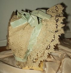 Lace and ribbon bedecked Edwardian child's bonnet.