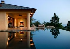 Soaring above Montecito Valley behind its infinity edge pool is the 4-bedroom, 6-bath home.