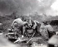 QF 25-pounder.    Australian Gunners of the 2/4th Field Regiment, RAA 71st Infantry Division were fired on the Japanese with a short version of the British 25 Pounder gun during the invasion of the island of Borneo in the Dutch East Indies July 1945.