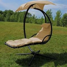 Freeport Park Macie Hanging Chaise Lounger with Canopy Umbrella Color: Beige Egg Swing Chair, Hanging Hammock Chair, Hammock Stand, Swinging Chair, Room Hammock, Hammock Balcony, Hanging Chairs, Porch Swing With Stand, Double Hammock With Stand