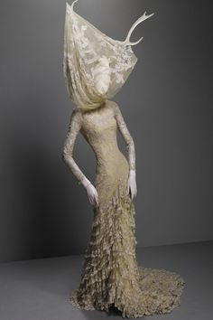 Alexander McQueen. If Miss Havisham was part deer, I'd picture her crazy old wedding dress to look like this.