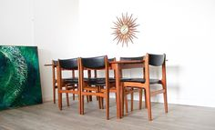 Nils Jonsson Troeds Burgvik Extendable Dining Table & 6 Chairs     This is a very stylish rare Swedish teak extendable dining table and 6 dining chairs.   Designed by Nils Jonsson for Troeds .   Featuring a single extending leaf which is stored underneath the table top when not in use - the table top simply slides forward to reveal the leaf which clips in place .   The chairs feature black leatherette upholstery.     Height  73cm Width   135cm / 185 cm extended Depth   85cm     Condition…