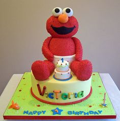 This baby Elmo cake is all edible. It's a combination of two other Elmo cakes that I've done in the past. Elmo is sitting on top of a cake. Sesame Street Cake, Sesame Street Birthday, 3d Cakes, Cupcake Cakes, Baby Cakes, Elmo And Friends, Elmo Birthday, Birthday Cakes, Birthday Ideas