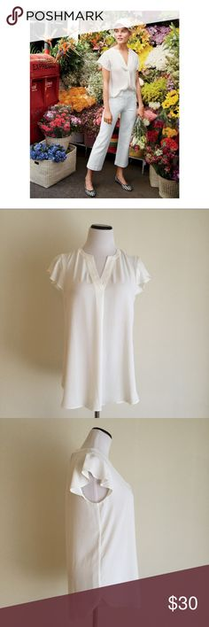 J. Crew Flutter Sleeve Blouse Never worn Flutter Sleeve Blouse by J. Crew in white. 100 % polyester, size 8 tall, 27 inches long, 19 inches armpit to armpit. Tops Blouses