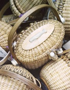 Nantucket baskets - I have several of these and I just love them!  When we visited Martha's Vineyard, I got a small silver Nantucket basket charm that opens.  And inside is a tiny copper penny! :)