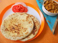 Paneer Kulcha - Ingredients: 2 cups all purpose flour/maida - 1/2 cup warm milk - 1/4 cup curd/yogurt -  1/4 tsp salt - 1/2 tsp sugar - 3/4 tsp baking pwd - water for kneading - 3 tsps sesame seeds - 2 tbsps butter/ghee. For stuffing: Mix all the ingredients and make small balls - 1/4 cup grated paneer - 1 onion finely chopped - 2 finely chopped green chilies - 1 tsp chaat masala - pinch of red chili pwd - salt to taste