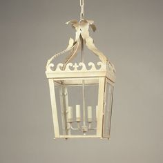A classic style for the foyer, but the washed white gives it an update,