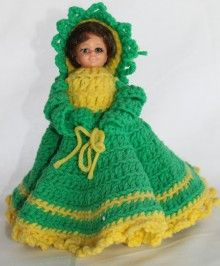 """nookcove - http://www.sellergroup.com/shop/nookcove  $2.99  Doll Stick Head Type with Crocheted Hat, Dress, and Arms  Doll Stick Head Type with Crocheted Hat, Dress, and Arms was crocheted and assembled by a local (Troy, TN) doll maker. The arms are crochet rather than using plastic doll arms. The head is a """"stick type"""" which sits in on a stryofoam cone. I call her the """"St Patrick's Day"""" doll. As you can see the dress is crocheted in green and yellow."""
