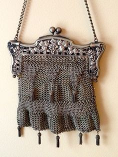 """Antique Art Nouveau French Silver Chainmail Purse on Ebay. """"Crafted shortly before the turn of the 20th century."""" 6"""" x 8"""" Chain 30"""" long w/15"""" drop. Gold woven silk lining."""