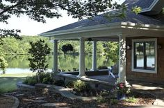 Spacious porch, low wall to accommodate for extra seating and better view.