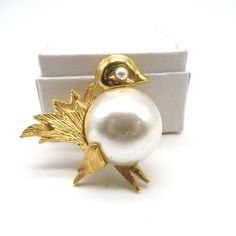 Vintage gold tone star flower brooch with faux pearls in a mid century modern style