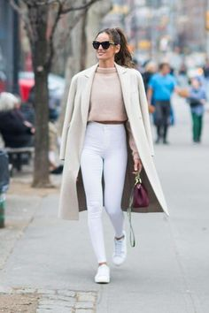 Model Off-Duty Izabel Goulart Cool And Casual Fashion Week Street Style High Waisted White Skinny Jeans Pink Cropped Fluffy Jumper And Cream Long Coat