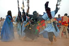 Tuaregs from Timia perform a dance 'le Dramague,' accompanied by spikes and swords during the annual Cure Salee (salt cure) festival in Ingall, Niger, Sept. 17, 2006. The nomadic tribes of Niger, Tuareg and Fulani, gather for one week in the Niger side of the Sahara because of the rich salt deposits and to rest, fatten their animals, give them the 'salt cure' and enjoy music, dance, and camel racing.