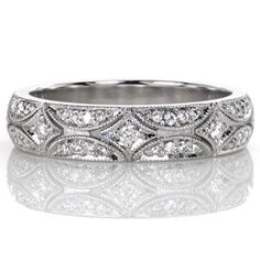 A dainty version of the North Star Band, this design still brings to mind a sky full of stars. It contains gleaming micro pavé diamonds set within a unique vintage inspired slim band. The pattern of alternating scallops and starbursts are embellished with diamonds and bright-cut with a milgrain outline. www.knoxjewelers.biz