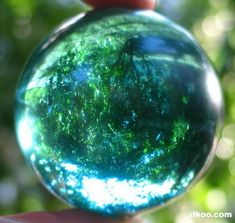 Ocean Blue Obsidian Sphere Crystal Ball from volcano lava pouring into ocean or lake water.