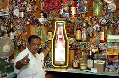 If you happen to be traveling through Central America, then you want to make a stop at perhaps the best airport bar in the world. Besides being the only bar in the Belize Airport, Jet's is known for their strong rum punch and hot dogs. However, it's the roughly 4′ 8″ proprietor, Mr. Jet of course, that makes this bar known across the Earth.