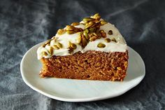 Pumpkin Cake with Cream Cheese Icing and Caramelized Pumpkin Seeds from Food52. Ways to use pumpkin puree...