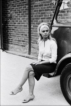 Brigitte Bardot in cardigan, pencil skirt, kitten heels, and headband