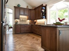 Greenberg - After moving in, the Greenbergs realized that the 1980's style kitchen had to go. We created a design to include new appliances, custom cabinets, beautiful countertops and wood flooring to turn this house into a home.