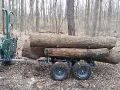 We build the load by chain lowering from the tractor loader so they don't slam around. This a bit more than 2k lbs. The log the tape is on is right around 1700lbs by itself. If i had to guess probably around 3k to 3800 lbs Ryan    #woodlandmills #mulilander #loggingtrailer #offroadtrailer #logging #ATV   www.woodlandmills.com Atv Utility Trailer, Atv Trailers, Tractor Loader, Off Road Trailer, T Rex, Tractors, Woodland, Chain, Chains
