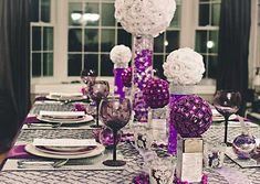 White and purple table decorations and centerpieces for a holiday soiree.