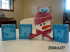 snow 2x4 craft : painted letters and snowman with stocking cap