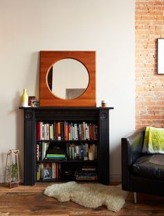 Turning an old mantel into a bookcase is an inspired DIY we'd like to try.