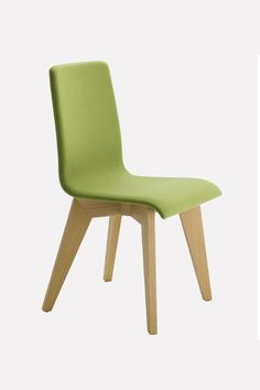 Nordic style design chair with a fresh green upholstery.