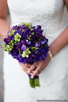 Purple and green wedding flower bouquet, bridal bouquet, wedding flowers, add pic source on comment and we will update it. www.myfloweraffair.com can create this beautiful wedding flower look.