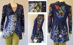 IVKO Woman`s  Wool Renaissance Jacket Style 32502 039 in NAVY. Chain and button front closure over hidden snap closure. Curved front hem lowers to pleated back topped with back embroidery panel of large intricate flowers on deep boiled wool panel in navy that wraps around to accentuate front waist. Super feminine, coming or going!