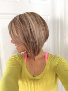 Dimensional blonde, low lights, highlights, a-line, angle bob, reverse bob cut. Shorter in back