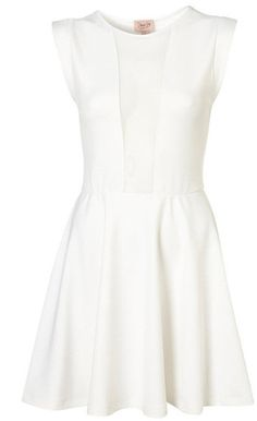 Love the simple white structured dress...that doesn't look like a wedding dress