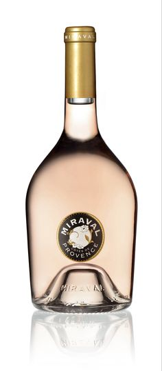 """Wine Spectator - Wine of the Day -  #ChateauMiraval Rosé 2014 - """"The finest rosé yet from this estate (the wine is made by the top notch team at Chateau Beaucastel), the light pink colored 2014 Cotes de Provence Rose sports a fresh and lively bouquet of wild strawberries, raspberries and white flowers to go with a supple, lightly textured, silky and seamless feel on the palate. About as gulp-able and hard to resist as they come, it's a killer rosé to drink over the coming 6-8 months."""""""