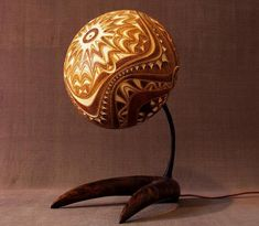 As an avid lamp collector, I about died when I saw these carved lamps made from dried gourds by Calabarte. Gourds from Senegal are meticulously hand drilled, allowing light to shine through the fine patterns. Absolutely stunning.