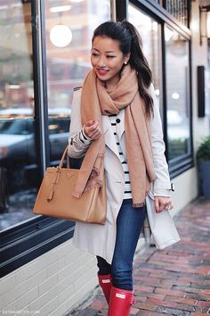 Rainy day casual outfit - Hunter red boots, Burberry trench coat, camel scarf and tote, striped tee