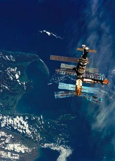 Astronauts aboard Space Shuttle Atlantis took this photograph of Soviet space station Mir over New Zealand as Atlantis approached Mir prior to docking on March 23rd, 1996.