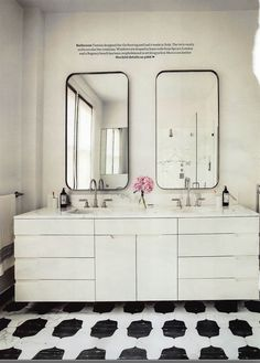 Love the cutouts for pulls, mirrors, tile, pretty much everything ...The mirrors in the master bath were designed by Volpe, and the sink fittings are by Dornbracht.