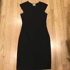 Carmen Marc Valvo black bodycon dress w/ lace back Beautiful and comfy bodycon dress. Hits at knee. High crew neck, cap style sleeves. See through back lace. Can also fit M (I am a 6/8) Carmen Marc Valvo Dresses