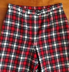 Time warp!  Everything old is new again with these true vintage Pendleton Red Plaid pants! Flat front and fully lined. Waist 28 with straight leg styling.  Not low waist.